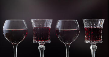 Red wine in different glass shapes